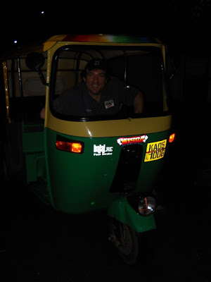Kenny's taking up a second job... moonlighting as a rickshaw driver