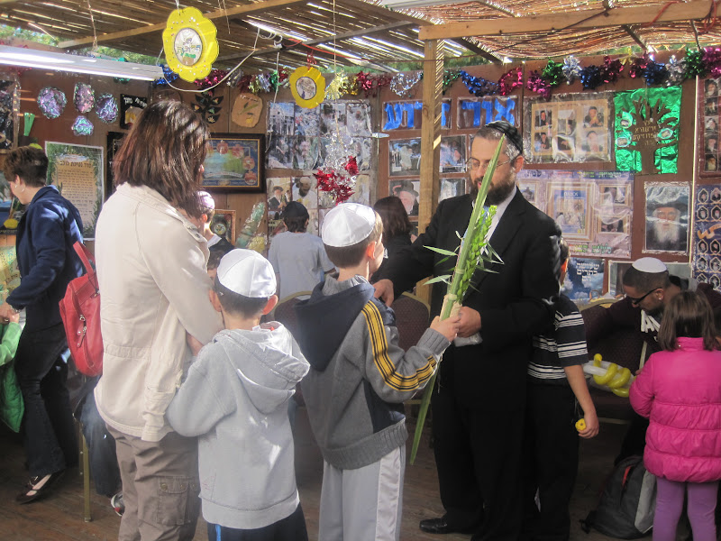 Hebrew school students lined up to shake a lulav and esrog with Rabbi Travitsky