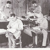 09.08 Lavori in Campo - Works in Camp - Sarti sono affacendati nel campo - Tailors are busily occupied at the P.O.W. Camp..jpg