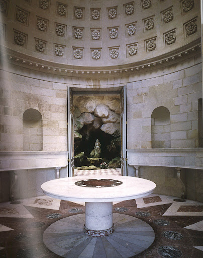 Louis XVI commissioned the painter Hubert Robert to oversee the creation of this pleasure diary for Marie Antoinette at Rambouillet. Drawing heavily upon ancient Greek precedents, the interior was further complimented with Neoclassical furniture designed by Robert himself. The circular table and colored marble floor were both added by Napoleon. (Regency Redux, Rizzoli)
