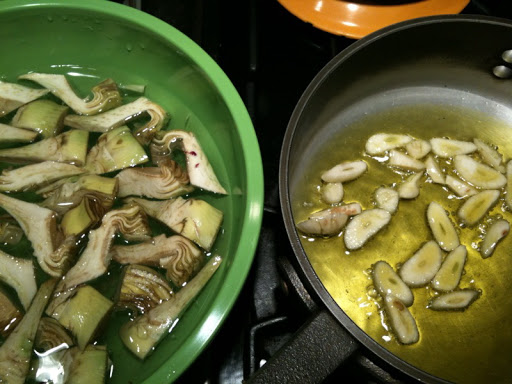 Garlic and olive oil getting ready for the artichokes.