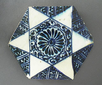 Tile | Origin: Syria | Period:  circa 1430 | Collection: The Madina Collection of Islamic Art, gift of Camilla Chandler Frost (M.2002.1.49) | Type: Ceramic; Architectural element, Fritware, underglaze-painted, Diameter: 7 7/8 in. (20 cm); Depth: 3/4 in. (1.91 cm)