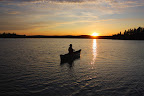Canoeing into the sunset in Obatanga Provincial Park