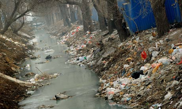 Rubbish and pollution blight a canal on the outskirts of Beijing. The average Beijinger has a footprint three times the Chinese average, says WWF. Mark Ralston / AFP / Getty Images