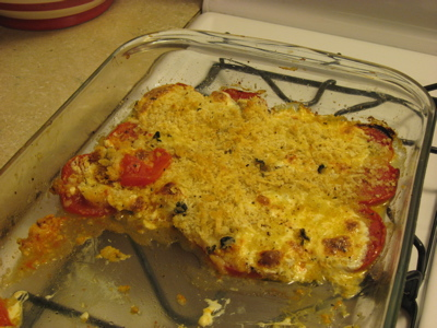A half-eaten tomato bake.
