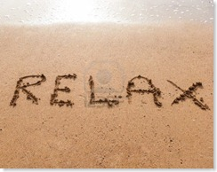 15446907-word-relax-in-handwriting-on-sandy-beach