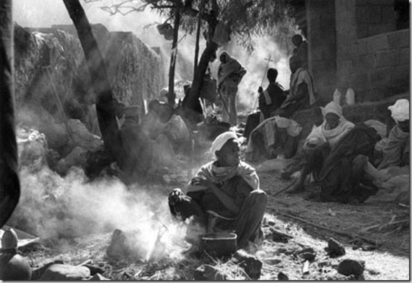 Pilgrims cooking beans during Christmas worship in the campground around Bet Madhane rock-hewn church. The basic food, always present in Amharic and Tigray houses, is the INJERA made by grain called teff, cultivate in highlands.