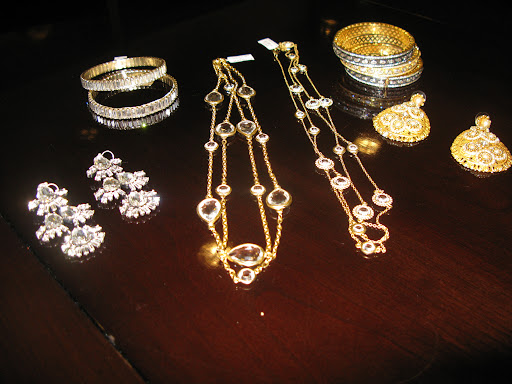 Jewelry from Jennifer Miller, earrings on the left from J.Crew.