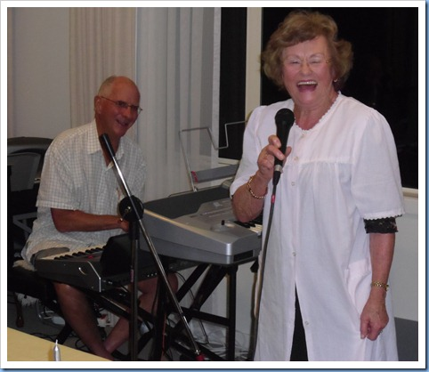 Bev Barnes had us 'in tuts of laughter' as she recited her 'Little White Nightie' song accompanied by John Perkin on the Korg Pa3X.