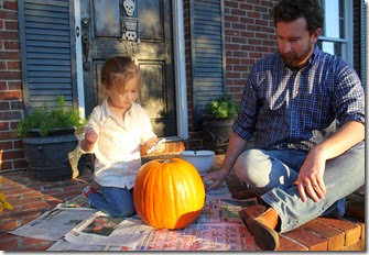 Zoey & Daddy carving pumpkin