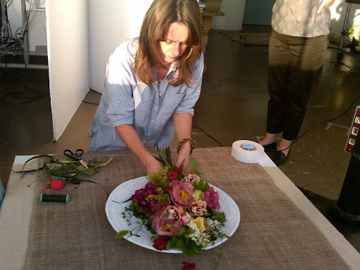 Livia, from The Green Vase, builds a bouquet.
