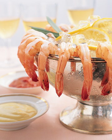 Shrimp Cocktail: Arrange shrimp along the rim of an ice-filled bowl (or on a platter) accompanied by lemon slices and cocktail sauce or lemon aioli.