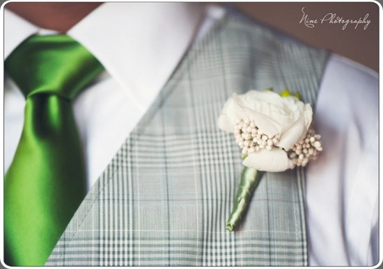 groom ranunculus bows and arrows