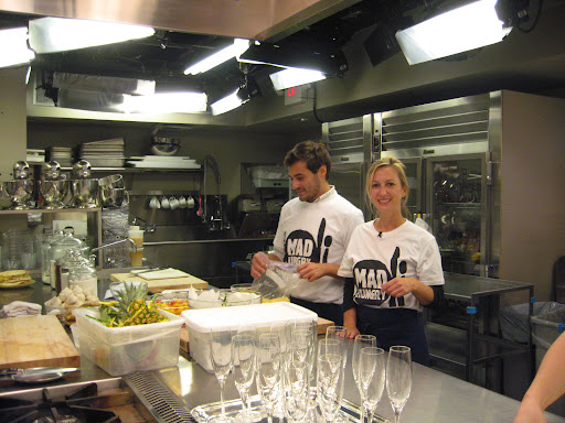 Sarah and Thomas preparing food for the show
