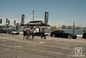 AccuAir booth at WekFest LA 2013 with TAG Motorsport's S4 and Low 'n Slow's 350z