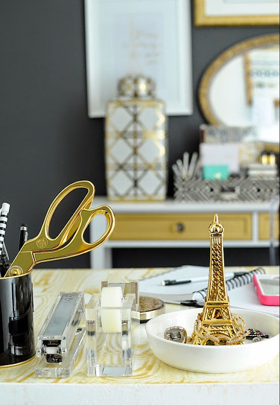 Check out this gold and white office from Monica Wants It-- she features lots of affordable DIY ideas.