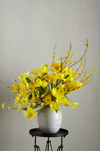 This arrangement was inspired by ikebana, the Japanese art of flower arranging.  Since tulip stems continue to grow even after they're cut, this arrange will change everyday.  I positioned the tall branches on one side and the short ones opposite.