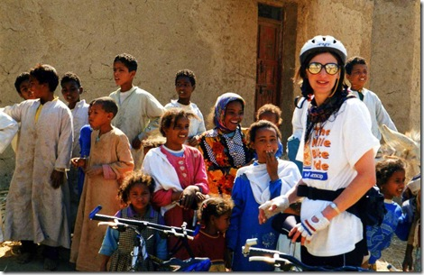 Claire Isherwood  on the Mencap Nile Bike Ride. Talking to some Egyptian Children she met at a water stop in Feb 2000