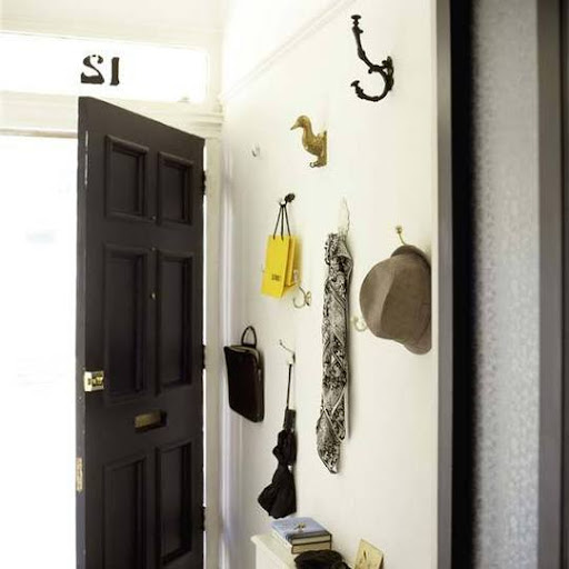 Hanging belongings on a collection of different hooks adds personality to an entryway. (apartmenttherapy.com)