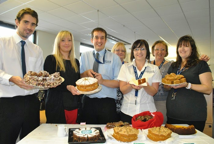 Garador staff with home-made cakes at Macmillan charity coffee morning