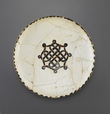 Bowl | Origin:  Iran or Afghanistan | Period: 10th century  Samanid period | Details:  Not Available | Type: Earthenware painted over transparent glaze | Size: W: 32.4  cm | Museum Code: F1953.70 | Photograph and description taken from Freer and the Sackler (Smithsonian) Museums.