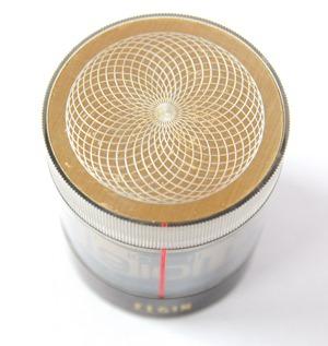 Elgin cylindrical tube rotating wind-up alarm clock