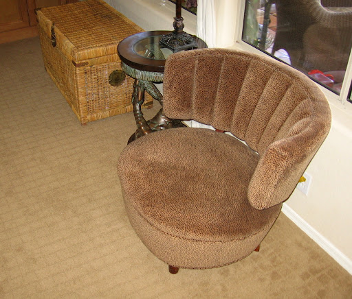 Lynda found this barrel chair in the trash at her grandmother's apartment complex. It was originally covered in an ugly green fabric so she simply recovered it with new fabric and voila!