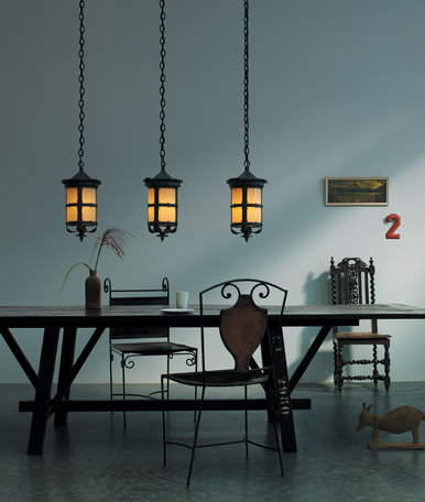 The Hathaway is an outdoor pendant but here it hangs inside over a dining table.