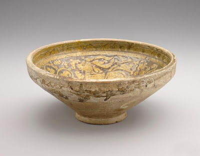 Bowl | Origin:  Garrus district,  Iran | Period: 12th-13th century | Details:  Not Available | Type: Earthenware with decoration carved through a white slip and coloring under a transparent glaze | Size: H: 10.9  W: 25.2  cm | Museum Code: F1925.8 | Photograph and description taken from Freer and the Sackler (Smithsonian) Museums.