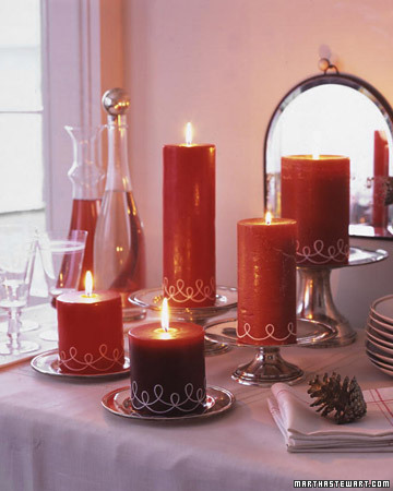 Decorate inexpensive pillar candles and you will have a display for your table and presents, too.