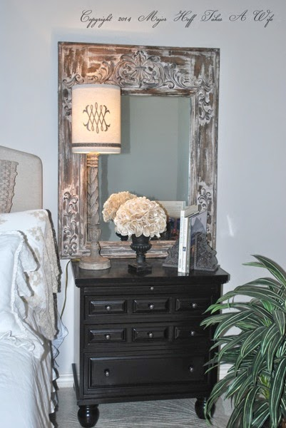 Bun feet black nightstand with lamp and tin surround mirror