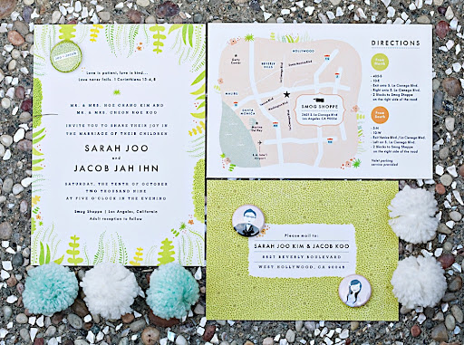 The full invitation suite, including buttons that match, photographed with Joo's yarn pom poms.  Photo by April Smith.
