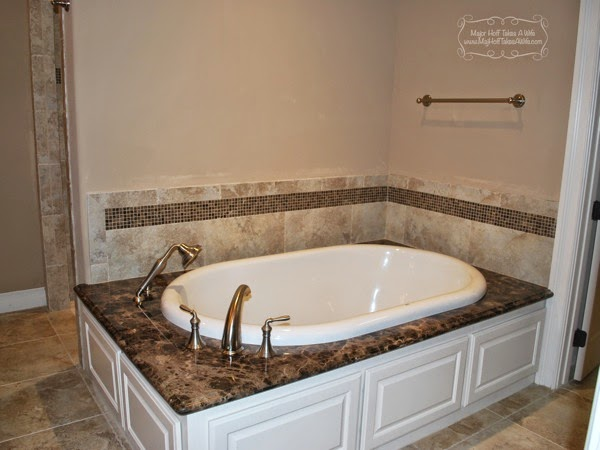 Master bath tub with shower sprayer and mosaic tile