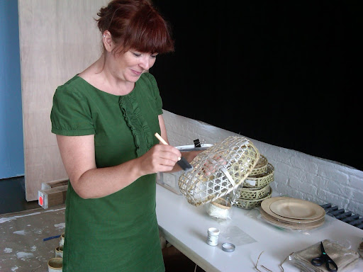 Jo, from The Green Vase, paints a basket for the wall hanging.