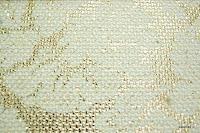 Tkanina meblowa z metalicznym efektem w kwiaty. Złota.