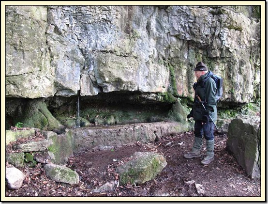 Allan inspects Silverdale's former water supply at Wood Well