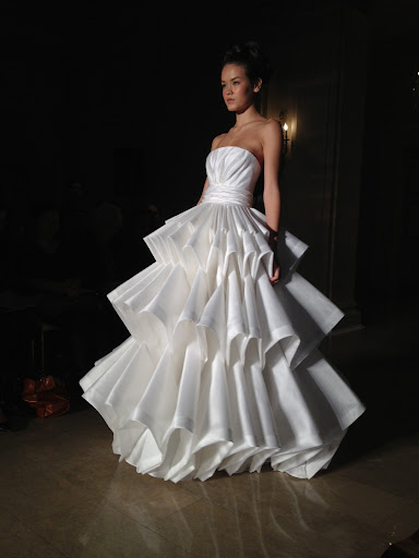 Pleats, please: How dramatic is the silhouette on this strapless number?