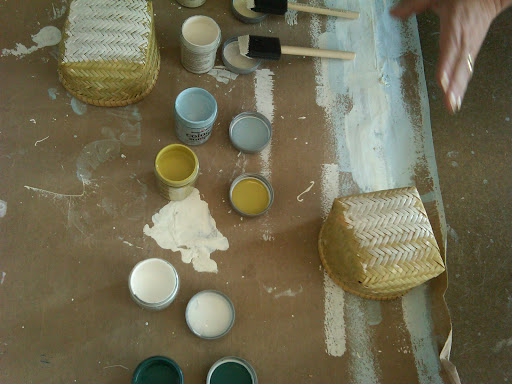 Here, we tested out paint colors on the baskets from Pearl River.