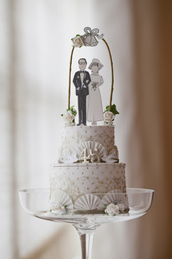 This D Sharp paper cake topper added some wedding flair to the dessert table.