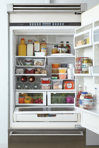This is the dream refrigerator! The Container Store, Bed Bath and Beyond, Martha Stewart Collection For Macy's, and Snapware have some wonderful storeage pieces for your refrigerator -- like clear leftover containers, soda holders, wine racks, and shelf risers.