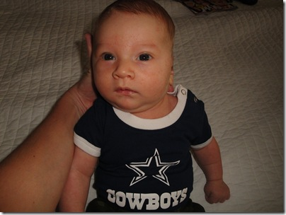 6.  Knox sitting up in cowboys gear