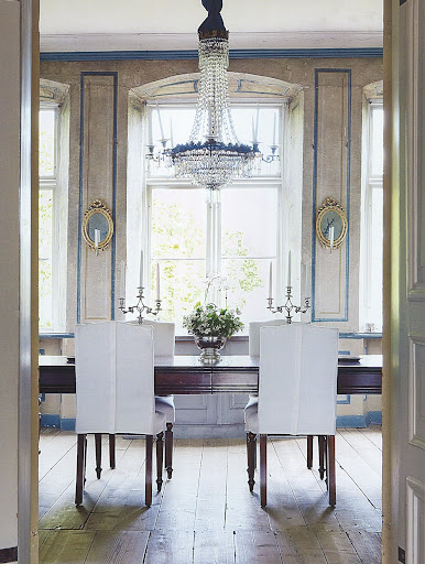 Tailored white slipcovers in an exquisite 1770s Swedish dining room.