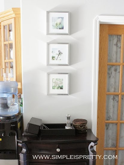 Pictures above dresser in entrance in new house www.simpleispretty.com
