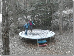 Girls, snowy trampoline