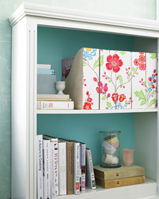 Inexpensive magazine holders get a romantic upgrade with a pretty floral paper. (Martha Stewart Living)