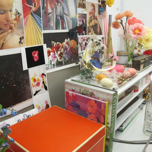 Hints of floral imagery decorate my bulletin board, echoing the colorful blossoms on my desk.