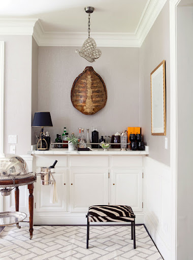 A single bright orange element draws similar hues out of a tortoise-shell wall element. The bold stripes on the zebra bench accentuate this statement. (www.designsponge.com)