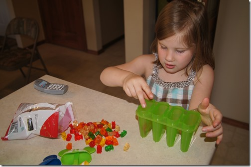 kids can help fill molds with gummy bears