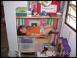 No, you cannot sleep in the dollhouse.