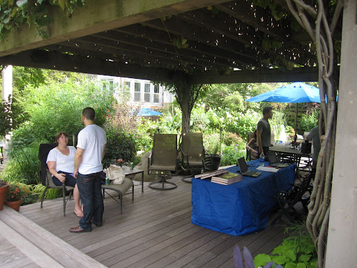 The deck has a pergola with lush grapevines covering the top. Here, Rick and his crew and putting the finishing touches on the space before the guests arrive.